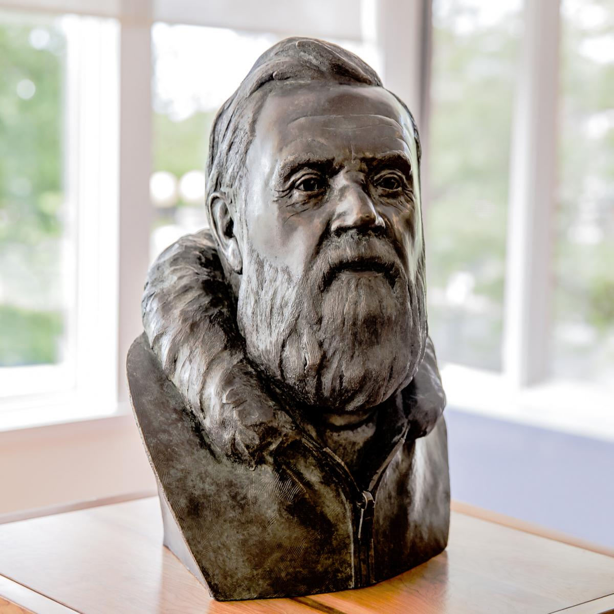 A carved bust of Farley Mowat